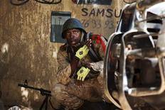 A Malian soldier looks on during fighting with Islamists in Gao, February 21, 2013. REUTERS/Joe Penney