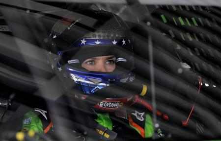 Danica Patrick adjusts her gear before leaving her garage in her number 10 Chevrolet during NASCAR Sprint Cup Series practice at the Daytona International Speedway in Daytona Beach, Florida February 22, 2013. REUTERS/Brian Blanco