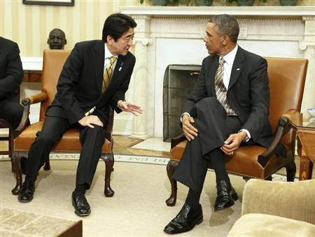 U.S. President Barack Obama talks with Japanese Prime Minister Shinzo Abe (L) in the Oval Office at the White House in Washington, February 22, 2013. REUTERS/Larry Downing