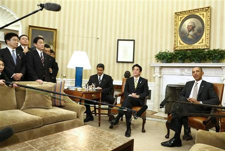 U.S. President Barack Obama (R) talks to the media next to Japanese Prime Minister Shinzo Abe in the Oval Office at the White House in Washington, February 22, 2013. REUTERS/Larry Downing