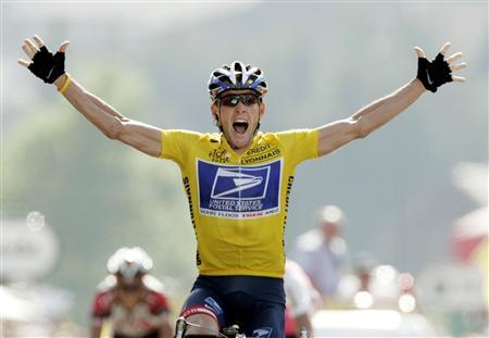 US Postal rider Lance Armstrong of the United States raises his hands as he crosses the finish line to win the 204.5 km long 17th stage of the Tour de France from Bourd-d'Oisans to Le Grand Bornand, France in this file photo from July 22, 2004. REUTERS/Wolfgang Rattay
