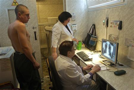 A man (L) is x-rayed to detect tuberculosis during a medical examination, organized by the Belarusian Red Cross society, in Minsk, January 29, 2013. REUTERS/Vasily Fedosenko