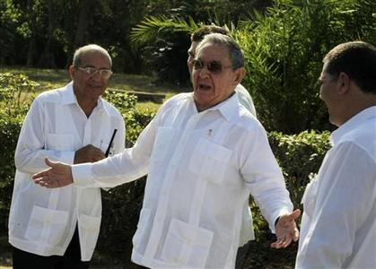 Cuba's President Raul Castro (C) gestures while talking to the media at the Soviet Soldier monument in Havana February 22, 2013. REUTERS/Enrique De La Osa