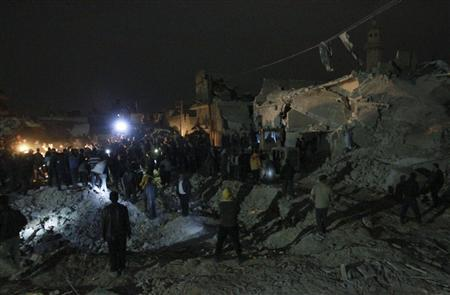 People gather to search for survivors under rubble after what activists said was a Scud missile hit in Aleppo's Tariq al-Bab neighbourhood February 22, 2013. REUTERS/Muzaffar Salman