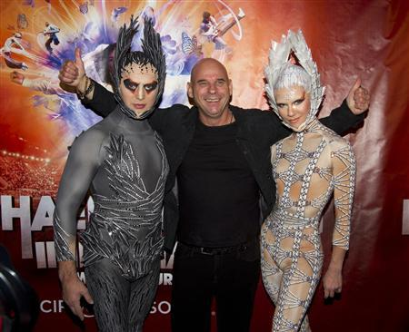 Guy Laliberte, CEO of Cirque du Soleil poses with performers as he attends the premiere of Michael Jackson THE IMMORTAL World Tour show by Cirque du Soleil in Montreal, October 2, 2011. REUTERS/Christinne Muschi