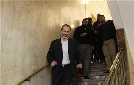 Syrian National Coalition leader Moaz Alkhatib leaves the Arab League headquarters after meeting with the Arab League head in Cairo February 11, 2013. REUTERS/Asmaa Waguih