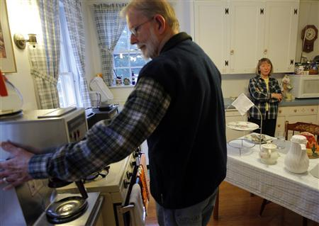 Ada May Roberts (R) and her husband Donald prepare breakfast for the guests at their Amelia Payson House Bed and Breakfast in Salem, Massachusetts October 30, 2011. REUTERS/Brian Snyder