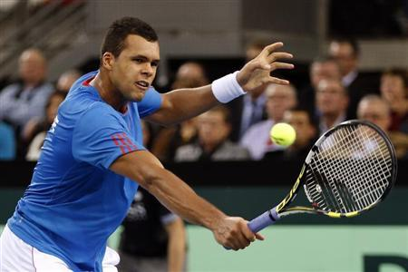 Jo Wilfried Tsonga of France returns the ball to Amir Weintraub of Israel during their first round Davis Cup tennis match in Rouen, February 1, 2013. REUTERS/Charles Platiau