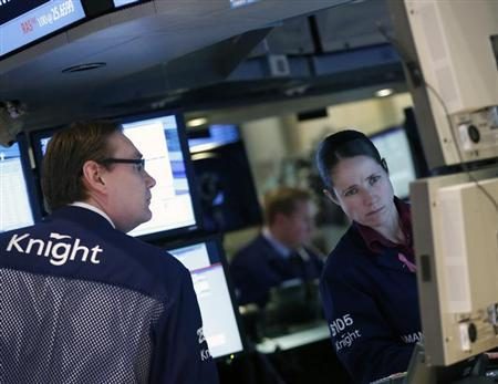 Traders work at the Knight Capital booth on the floor of the New York Stock Exchange, February 19, 2013. REUTERS/Brendan McDermid/Files