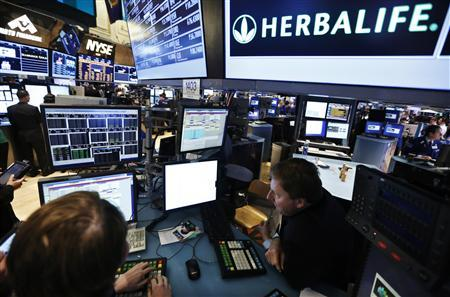 Traders work at the post that trades Herbalife stock on the floor of the New York Stock Exchange in this January 10, 2013 file photograph. REUTERS/Brendan McDermid/Files