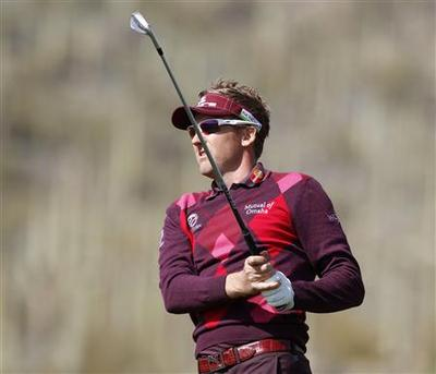 Donald exits, Mahan and Poulter advance