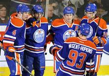 Edmonton Oilers' (L-R) Taylor Hall, Sam Gagner, Jordan Eberle, Ryan Nugent-Hopkins and Justin Schultz celebrate a goal against the Los Angeles Kings during the second period of their NHL hockey game in Edmonton February 19, 2013. REUTERS/Dan Riedlhuber