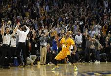 Golden State Warriors Jarrett Jack celebrates after making a three-point basket against the San Antonio Spurs late in regulation play during the second half of their NBA basketball game in Oakland, California February 22, 2013. REUTERS/Robert Galbraith