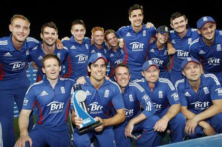 The England team celebrate winning against New Zealand during the final cricket match and the series of their one day international series at Eden Park, Auckland February 23, 2013. REUTERS/Nigel Marple