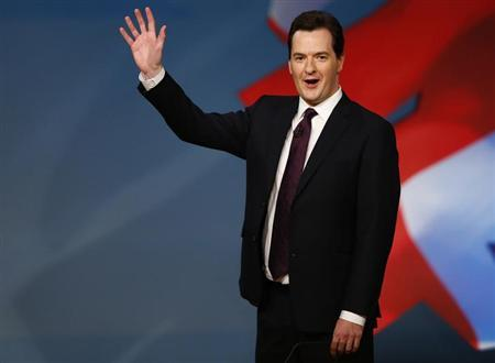Britain's Chancellor of the Exchequer, George Osborne, is seen waving after delivering his keynote speech at the Conservative Party conference in Birmingham, central England in this October 8, 2012 file photograph. Britain suffered its first ever sovereign ratings downgrade from a major agency on February 22, 2013 when Moody's stripped the country of its coveted top-notch triple-A rating, dealing a major blow to finance minister George Osborne. REUTERS/Darren Staples (BRITAIN - Tags: POLITICS)