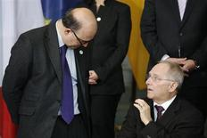German Finance Minister Wolfgang Schaeuble (R) talks with his French counterpart Pierre Moscovici. REUTERS/Thomas Peter