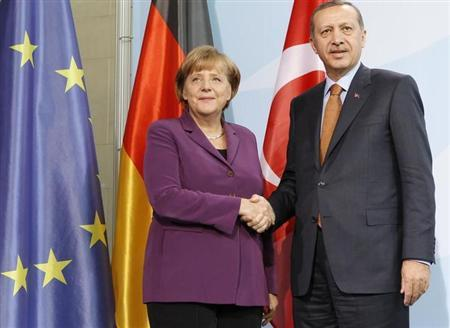 German Chancellor Angela Merkel and Turkish Prime Minister Tayyip Erdogan shake hands as they speak to media after meeting in the Chancellery in Berlin November 2, 2011. REUTERS/Fabrizio Bensch (GERMANY - Tags: POLITICS)