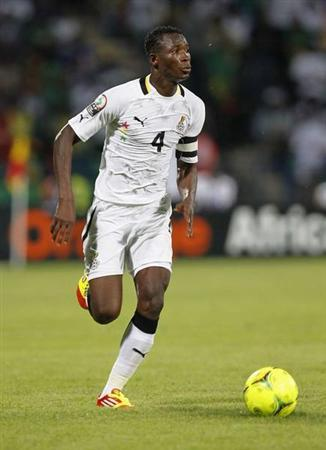 Ghana's John Paintsil runs with the ball during their African Nations Cup Group D soccer match against Mali in Franceville Stadium January 28, 2012. REUTERS/Louafi Larbi
