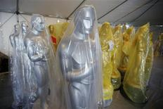 Silver Oscar statues stand beside gold statues during preparations for the 85th Academy Awards in Hollywood, California February 20, 2013. REUTERS/Danny Moloshok