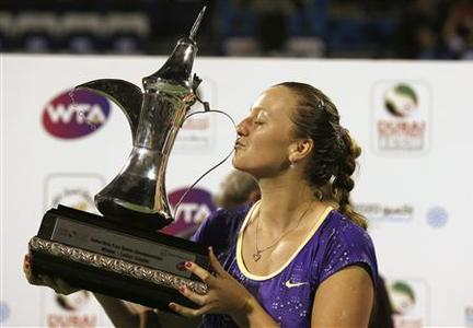 Petra Kvitova of the Czech Republic kisses the winner's trophy after her women's singles final match against Sara Errani of Italy during the WTA Dubai Tennis Championships, February 23, 2013. REUTERS/Mohammed Salem