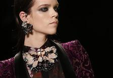 A model displays a creation from Roberto Cavalli Autumn/Winter 2013 collection at Milan Fashion Week February 23, 2013. REUTERS/Tony Gentile