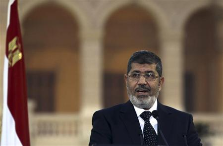 Egyptian President Mohamed Mursi speaks during a news conference with Turkish President Abdullah Gul (not pictured) after their meeting at Presidential Palace ''Qasr Al Quba'' in Cairo February 7, 2013. REUTERS/Amr Abdallah Dalsh
