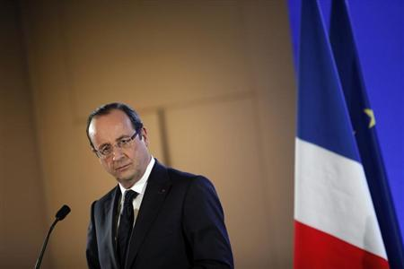 French President Francois Hollande attends a news conference during his visit to the 50th International Agricultural Show in Paris, February 23, 2013. REUTERS/Thibault Camus/Pool