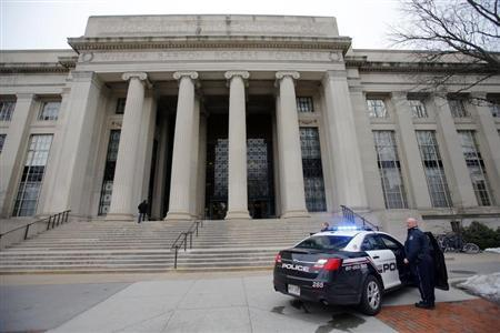 Cambridge police officers stand outside the main buildings of the Massachusetts Institute of Technology (MIT) in Cambridge, Massachusetts, February 23, 2013. REUTERS/Brian Snyder