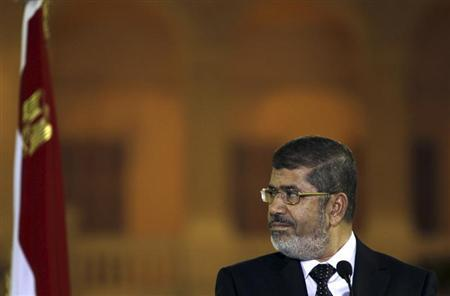 Egyptian President Mohamed Mursi attends a news conference with Turkish President Abdullah Gul (not pictured) after their meeting at Presidential Palace ''Qasr Al Quba'' in Cairo February 7, 2013. REUTERS/Amr Abdallah Dalsh