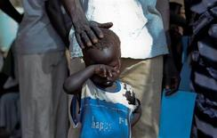 A boy who fled a war across the border in Sudan's Blue Nile state waits in a queue outside a clinic in Doro refugee camp, March 9, 2012. Sudan is fighting a civil war on multiple fronts in Darfur, South Kordofan and Blue Nile, with almost 100,000 fleeing across the border into the newly-independent South Sudan. REUTERS/Hereward Holland