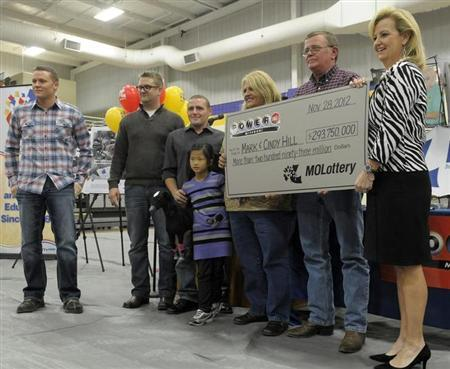 The Hill family holds an oversized check presented by Missouri Lottery director May Scheve (R) during a news conference at the North Platte High School in Dearborn, Missouri, November 30, 2012. REUTERS/Dave Kaup