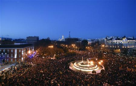 Demonstrators stage a protest against austerity, near the Spanish Parliament in Madrid February 23, 2013. REUTERS-Juan Medina