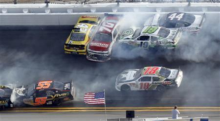 NASCAR drivers crash in an eleven car pile-up late in the NASCAR Nationwide Series DRIVE4COPD 300 race at the Daytona International Speedway in Daytona Beach, Florida February 23, 2013. REUTERS/Pierre Ducharme