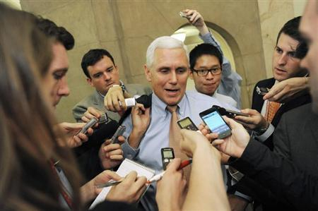 U.S. Representative Mike Pence (R-IN) (C) talks with reporters as he departs a meeting about debt ceiling legislation with fellow Republicans at the U.S. Capitol in Washington, July 28, 2011. REUTERS/Jonathan Ernst