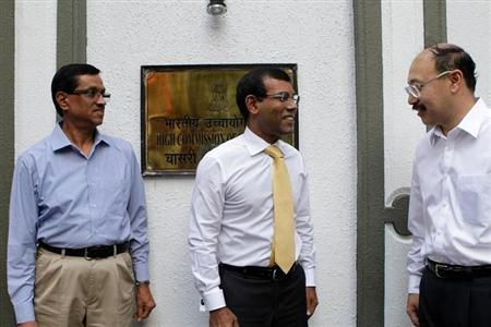 Former Maldives President Mohamed Nasheed (C) leaves the Indian High Commission in Male February 23, 2013. REUTERS/Stringer