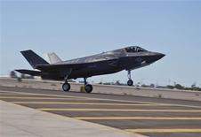 A U.S. Marine Corps F-35B lands at the Marine Corps Air Station in Yuma, Arizona in this handout photo taken November 20, 2012. The Pentagon on Friday suspended the flights of all F-35 fighter planes after a routine inspection revealed a crack on a turbine blade in the jet engine of an F-35 test aircraft in California. REUTERS/U.S. Marine Corps/DVIDS/Cpl. Shelby Shields/Handout