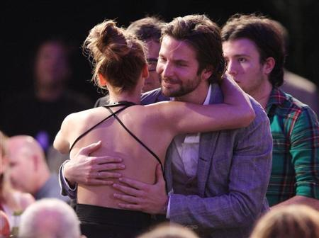Actor Bradley Cooper congratulates actress Jennifer Lawrence for winning the best female lead award for ''Silver Linings Playbook'' at the 2013 Film Independent Spirit Awards in Santa Monica, California February 23, 2013. REUTERS/David McNew