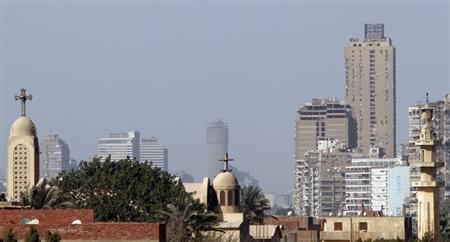 A minaret of a mosque is seen beside a church in Cairo February 23, 2013. REUTERS/Amr Abdallah Dalsh