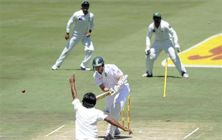 Pakistan's Rahat Ali celebrates after taking the wicket of South Africa's Kyle Abbott on the second day of the third cricket test match in Pretoria, February 23, 2013. REUTERS/Ihsaan Haffejee