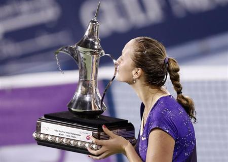 Petra Kvitova of the Czech Republic kisses the winner's trophy after her women's singles final match against Sara Errani of Italy during the WTA Dubai Tennis Championships, February 23, 2013. REUTERS/Ahmed Jadallah