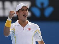 Kei Nishikori of Japan celebrates during his men's singles match against Evgeny Donskoy of Russia at the Australian Open tennis tournament in Melbourne January 18, 2013. REUTERS/Daniel Munoz