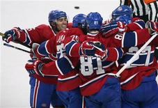 Montreal Canadiens Lars Eller (81) celebrates his goal over the New York Rangers goalie Martin Biron (not pictured) with teammates Francis Bouillon (L), P.K. Subban (76) Alex Galchenyuk (27) and Erik Cole (R) during second period NHL hockey action in Montreal, February 23, 2013. REUTERS/Christinne Muschi