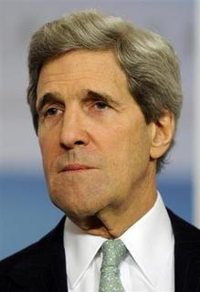 U.S. Secretary of State John Kerry listens to remarks by UN Secretary General Ban Ki-moon to the media before their bilateral meeting at the State Department in Washington February 14, 2013. REUTERS/Mike Theiler