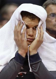 Los Angeles Clippers' Blake Griffin reacts on the bench as the Clippers trail the San Antonio Spurs during the fourth quarter of an NBA basketball game in Los Angeles February 21, 2013. REUTERS/Danny Moloshok