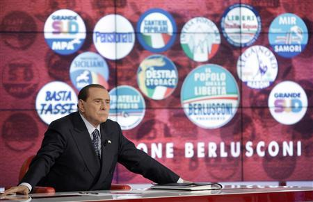 Italy's former Prime Minister Silvio Berlusconi reacts as he appears as a guest on the RAI television show Porta a Porta (Door to Door) in Rome February 22, 2013. REUTERS/Remo Casilli