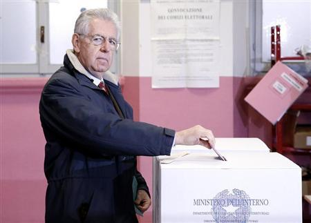 Outgoing Prime Minister Mario Monti casts his vote at the polling station in Milan, February 24, 2013. REUTERS/Stefano Rellandini
