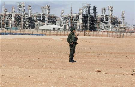 An Algerian soldier stands near the Tiguentourine Gas Plant in In Amenas, 1600 km (994 miles) southeast of Algiers, January 31, 2013. REUTERS/Louafi Larbi