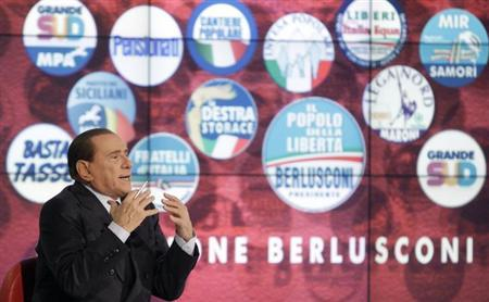 Italy's former Prime Minister Silvio Berlusconi gestures as he appears as a guest on the RAI television show Porta a Porta (Door to Door) in Rome February 22, 2013. REUTERS/Remo Casilli (ITALY - Tags: POLITICS ELECTIONS)