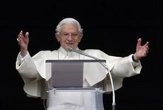 Pope Benedict XVI gestures as he leads his last Sunday Angelus prayer before stepping down in Saint Peter's Square at the Vatican February 24, 2013. REUTERS/Alessandro Bianchi