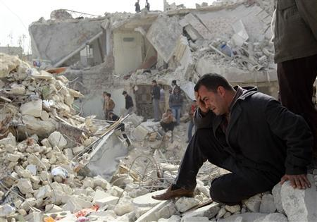 A man cries at a site hit on Friday by what activists said was a Scud missile in Aleppo's Ard al-Hamra neighbourhood, February 23, 2013. Rockets struck eastern districts of Aleppo, Syria's biggest city, on Friday, killing at least 29 people and trapping a family of 10 in the ruins of their home, activists in the city said. REUTERS/Muzaffar Salman